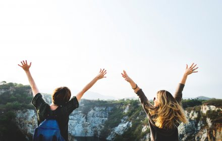 improve mental health, nature, two people with hands in the air