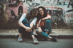 youth, teenage girls sitting, grunge background