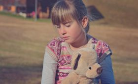 sad child, helping kids cope with grief
