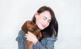 mental health benefits of pets, woman holding dog