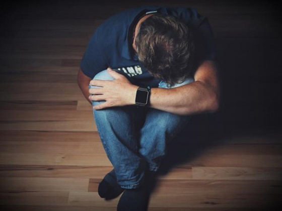 coping with grief, sad man